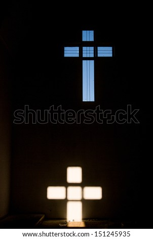 religion cross in the dark wall of church - stock photo