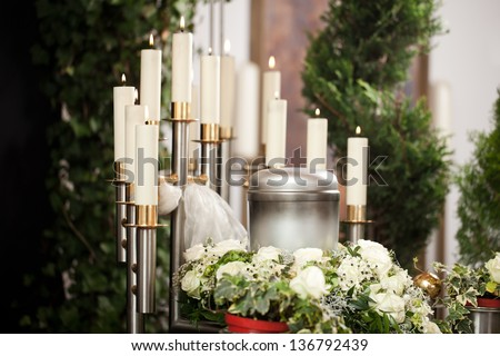 Religion, death and dolor - urn funeral and cemetery - stock photo