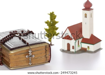 religion symbol with church and bible book - stock photo