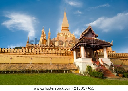 Religious architecture and landmarks. Golden buddhist pagoda of Phra That Luang Temple under blue sky. Vientiane, Laos travel landscape and destinations - stock photo
