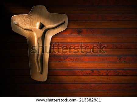Religious Background - Wooden Crucifix / Light brown wooden crucifix on dark brown wooden background with beams of light - Christian religion background - stock photo