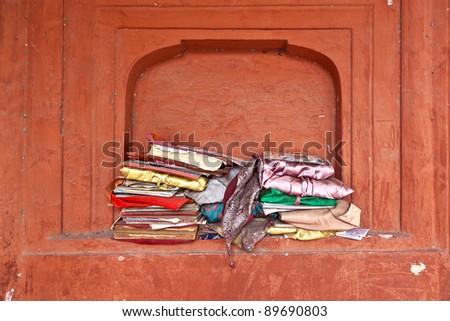 religious books in a window in Jama Masjid Mosque, old Delhi, India. - stock photo