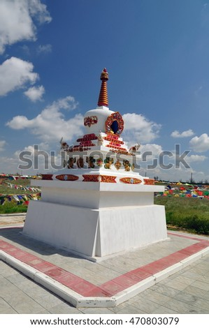 Religious Buddhist monument with colorful flags
