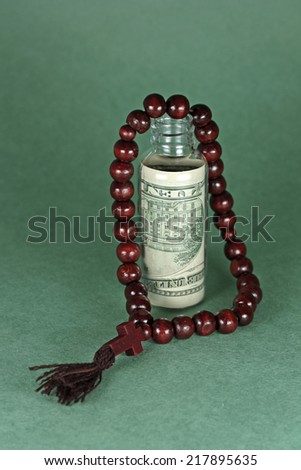 Religious concept - donations as business, on green backdrop - stock photo