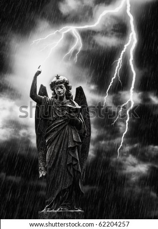 Religious concept image, lightning striking a statue of the angel Gabriel - stock photo