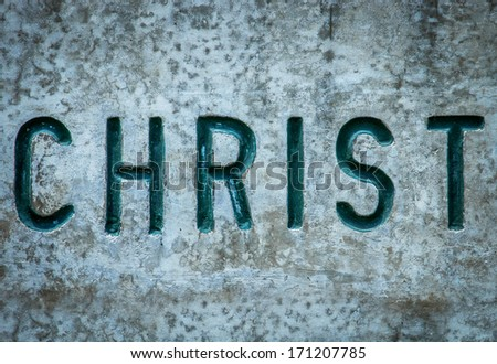 Religious Concept Image Of The Word Christ Chiseled Into Wall - stock photo