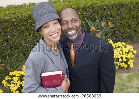 Religious Couple with Bible - stock photo