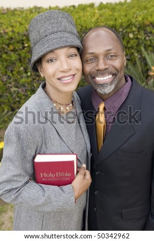 Religious Couple with Bible in garden, portrait, high angle view - stock photo