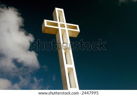 Religious cross against sky background - stock photo
