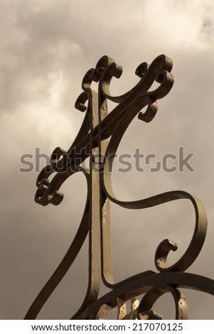 Religious cross on cemetery - stock photo