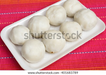 Religious food for Christians made of rice flour, filling of grated coconut and jaggery, for Easter, Palm Sunday, Oshana Sunday eve celebrations of Saint Thomas Christians in Kerala India. - stock photo