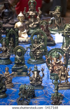 Religious idols for sale at a market in India - stock photo