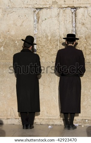 "Religious Jewish pray at the ""Western Wall""  in Jerusalem - stock photo"