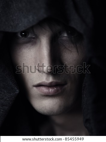 Religious man in pastor hood. Color photo - stock photo