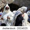 Religious men conducting Jewish rituals - stock photo