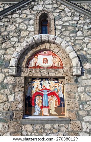 Religious painting on facade of the Templar Church in Bran, Romania - stock photo