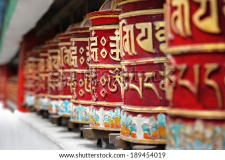 Religious prayer wheels in Bhutan - stock photo