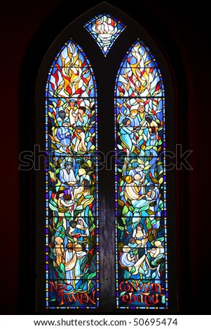 Religious stained glass depicting stories from the Bible.
