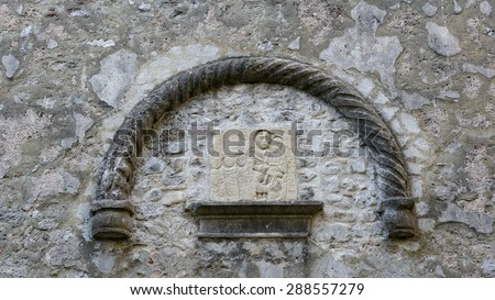 Religious symbols carved in stone - stock photo