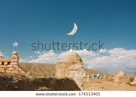 Religious symbols on the old tombs and gravestones of Muslim cemeteries in Asia at the bright day  - stock photo