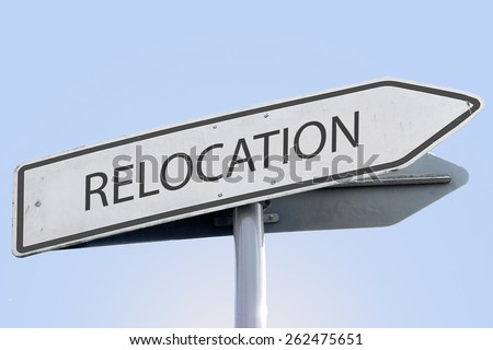 RELOCATION word on road sign - stock photo