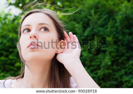 Relying on hand-ear listening the Good news - stock photo