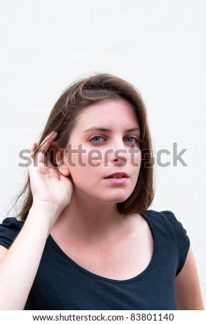 Relying on hand-ear listening young woman