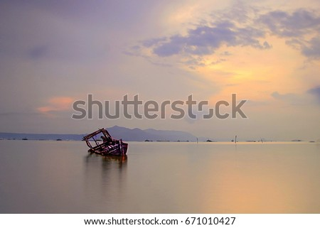 Remain Of Sunken Wooden Ship Captured In The Morning With Reflection Sun Light