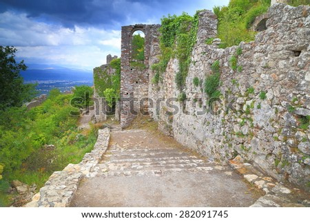 Remaining walls of the Byzantine city of Mystras under green ivy, Peloponnese, Greece