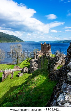 Remainings of the Urquhart Castle in Loch Ness in Scotland. Loch Ness is a city in the Highlands in Scotland in the United Kingdom. - stock photo