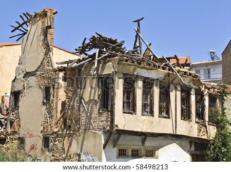Remains of a destroyed house - stock photo