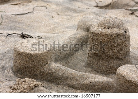 Remains of a sand castle - stock photo