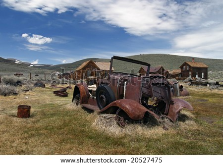 Remains of an old car in the ghost town of Bodie - stock photo