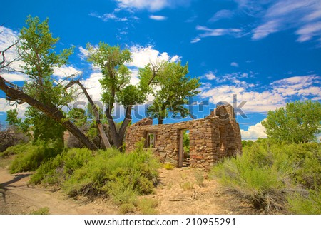 Remains of an old stone house with its roof caved in the wilds of Utah. - stock photo