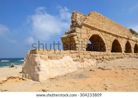 remains of ancient roman aqueduct at Ceasarea along the coast of the Mediterranean Sea, Israel - stock photo