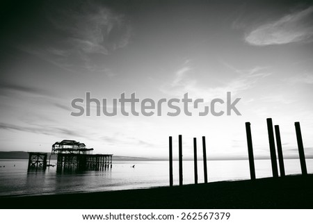 Remains of Brighton Pier left standing in sea at sunset, Brighton West Pier, England, UK - stock photo