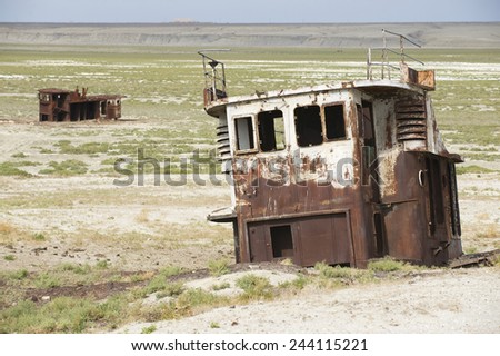Remains of fishing boats at the sea bed of the Aral sea, Aralsk, Kazakhstan. Evaporation of one of four largest lakes in the world is considered one of the planet's worst environmental disasters.