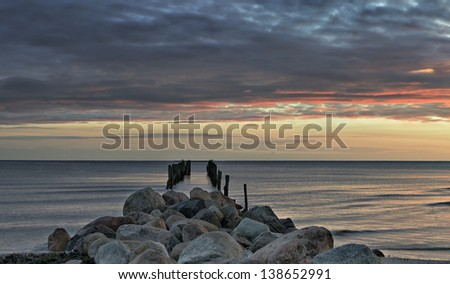 Remains of old fishing pier at dawn, Baltic Sea, Latvia, Europe - stock photo