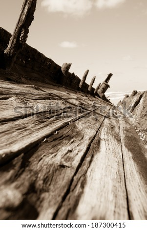 Remains of teak decking from the Fraser Island shipwreck, the Maheno in sepia. - stock photo