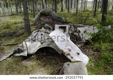 remains of the car in forest, horizontal - stock photo