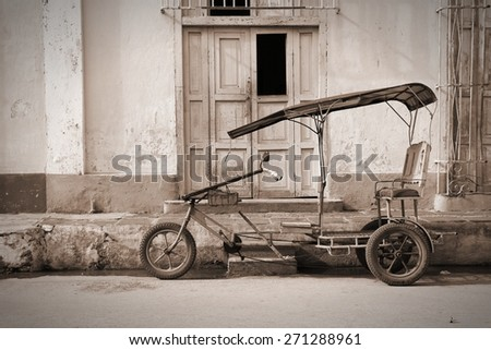 Remedios, Cuba - typical bici taxi, Cuban rickshaw. Sepia tone - retro monochrome color style. - stock photo