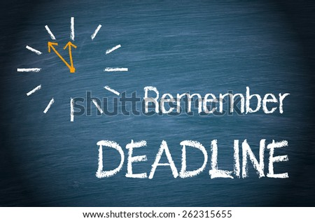 Remember Deadline - clock and text on blue chalkboard background - stock photo