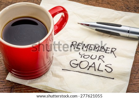 remember your goals - handwriting on a napkin with a cup of epsresso coffee - stock photo