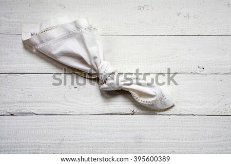 reminder, knot in an old  handkerchief on a white painted wooden floor with copy space, vitage style, concept of alzheimer's disease and dementia - stock photo