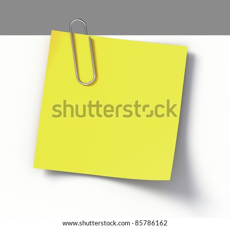 Reminder note with paper-clip - stock photo