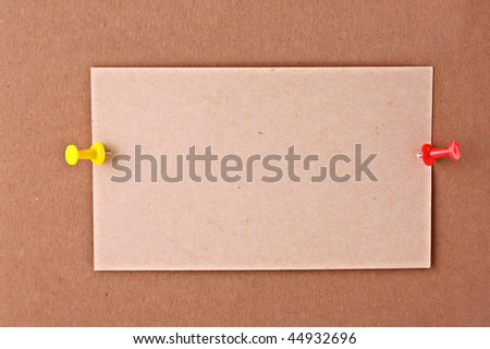 reminder notes  with pin on cardboard