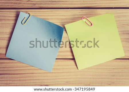 Reminder sticky note on wooden background, empty space for text - stock photo