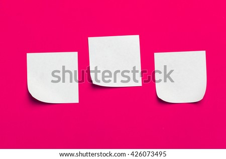 Reminder sticky notes on red background - stock photo