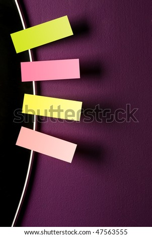 reminders on violet wall - stock photo