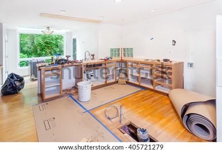 Remodel begins - demolishing existing cabinets and removing a pony wall - stock photo